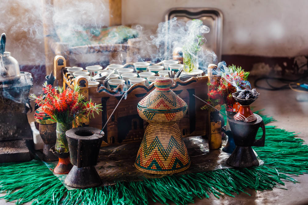 Traditional cup of Ethiopian coffee served with aromatic essence. Ceremony with Incense, usually frankincense and myrrh ignited by a hot coal to produce smoke that carries away any bad spirits. Ethiopia, Africa